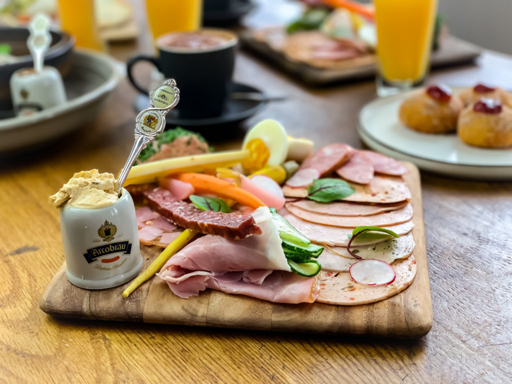 German Brunch Platter: Cold cut meats, cheese, veggies, Liverwurst, Obatzda served with bread and Bretzel.